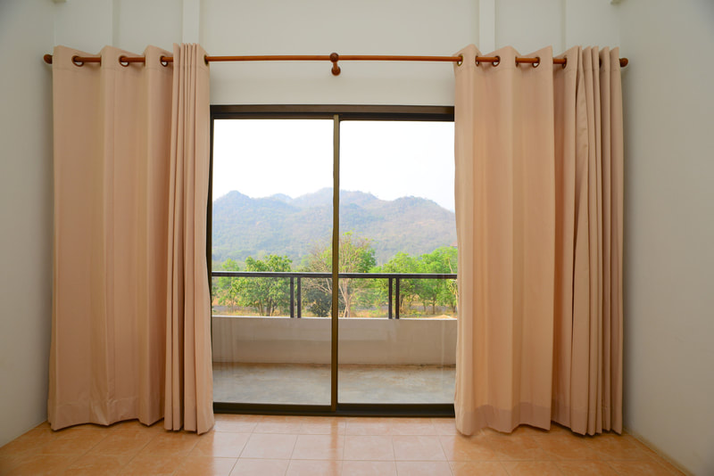 glass window with drapes